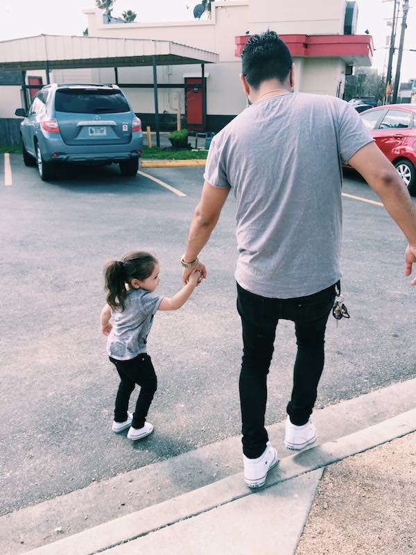Daddy And Daughter Holding Hands Walking