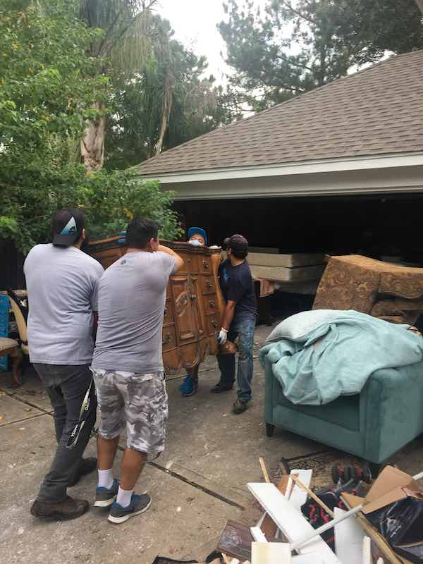 Men Moving Furniture Hurricane Harvey Relief